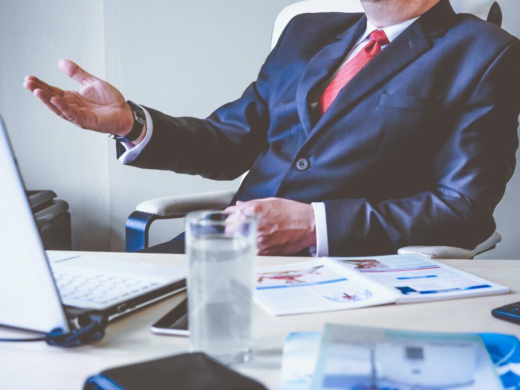 business man at desk talking